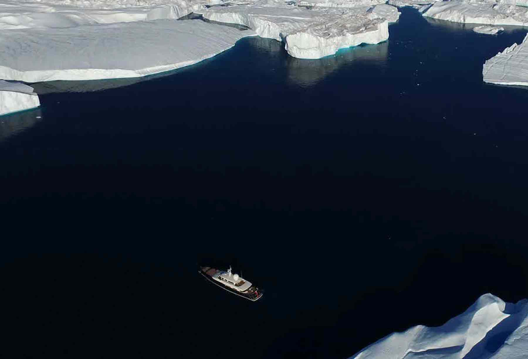 arial view of explorer superyacht and icebergs